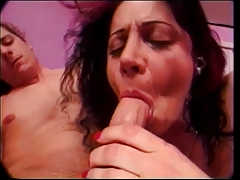 Brunette licks balls before giving deepthroat blowjob