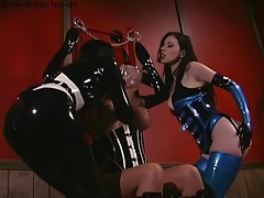 2 latex lesbians doing breath play on sub